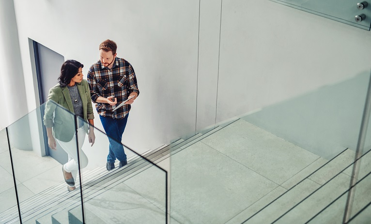 colleagues chatting on a stairwell